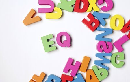 Isolated Colorful Wooden Word EQ or Emotional Quotient Stok Fotoğraf
