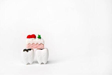 A Piece of Cake Model on Sad Teeth Model Be Decayed Tooth, If You Eat a Lot of Sugar