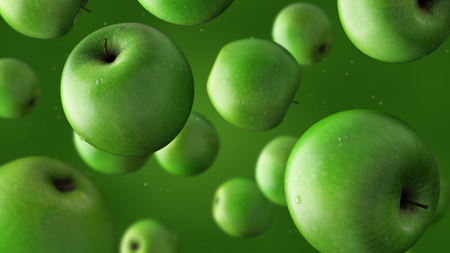 green apples: Falling green apples and water drops against green background