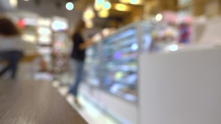pastry shop: Girl choosing chocolates in a pastry shop