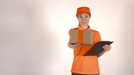 carreer: Courier in orange uniform giving a parcel