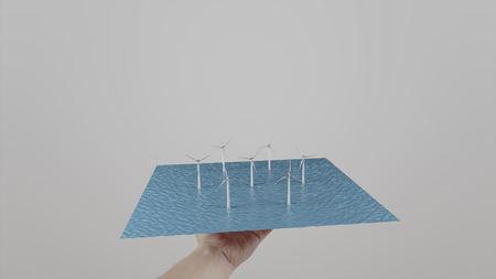 ecologic: Man twists in hand wind generators located on water. Light gray background. Alternative ecologic power generation