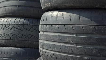 landfill site: Stacks of old car tires