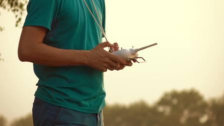 rc: Man using drone RC remote