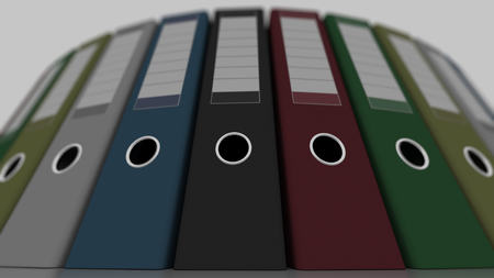 low angle: Colored office binders, low angle wide shot, shallow focus. 3D