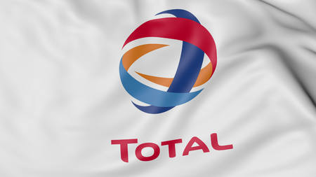 Close up of waving flag with Total logo, United States