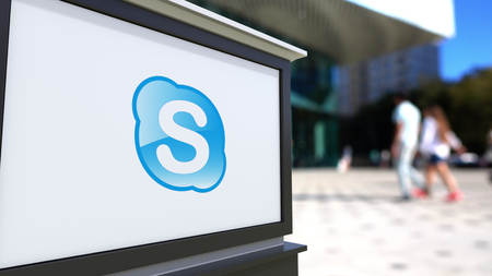 background skype: Street signage board with Skype logo. Blurred office center and walking people background. Editorial 3D rendering United States