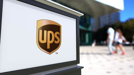 Street signage board with united parcel service ups logo blurred