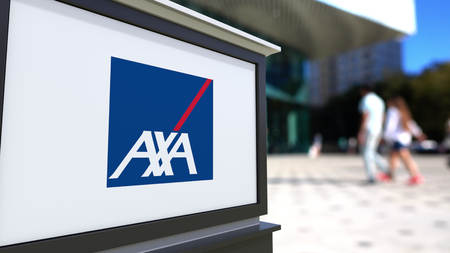 transnational: Street signage board with AXA logo. Blurred office center and walking people background. Editorial 3D rendering United States Editorial