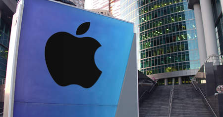 Street signage board with Apple Inc. logo. Modern office center skyscraper and stairs background. Editorial 3D rendering United States