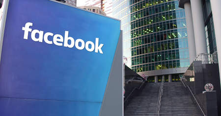 Street signage board with Facebook inscription United States