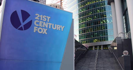 Street signage board with 21st Century Fox logo. Modern office center skyscraper and stairs background. Editorial 3D rendering United States