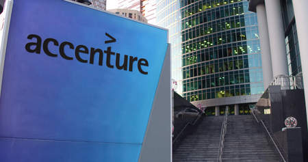 Street signage board with Accenture logo. Modern office center skyscraper and stairs background. Editorial 3D rendering United States Zdjęcie Seryjne - 66238493