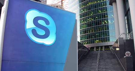 background skype: Street signage board with Skype logo. Modern office center skyscraper and stairs background. Editorial 3D rendering United States Editorial