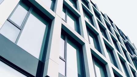 low angle: Modern business center. Panoramic windows of an office building, low angle clip