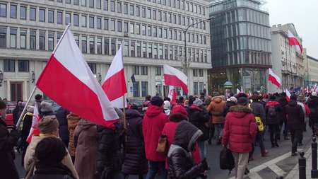 manifest: WARSAW, POLAND - DECEMBER, 17, 2016. Crowd with Polish flags marching in the street Editorial