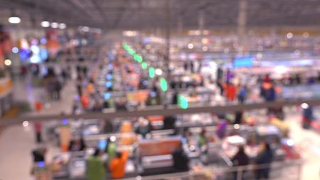 checkout: Blurred supermarket checkout area, view from above