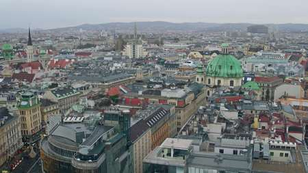 lowrise: Old low-rise and modern buildings roofs in Vienna on a cloudy day, Austria Stock Photo