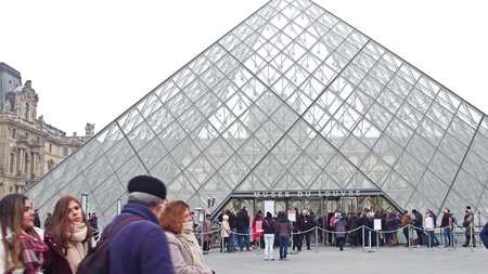 PARIS, FRANCE - DECEMBER, 31, 2016. People standing in line to enter the Louvre, famous French museum and popular touristic destination