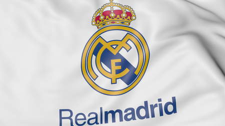 Close-up of waving flag with Real Madrid C.F. football club logo Editorial
