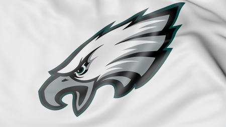 Close-up of waving flag with Philadelphia Eagles NFL American football team logo, 3D rendering 에디토리얼