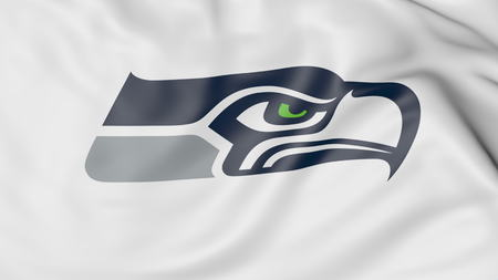 seahawks: Close-up of waving flag with Seattle Seahawks NFL American football team logo, 3D rendering