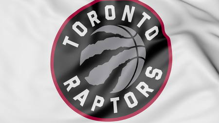 Close-up of waving flag with Toronto Raptors NBA basketball team logo, 3D rendering Editoriali