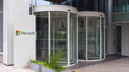 microsoft: Street signage board with Microsoft logo. Modern office building. Editorial 3D rendering Editorial