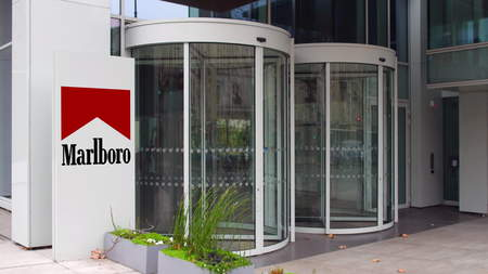 Street signage board with Marlboro logo. Modern office building. Editorial 3D rendering
