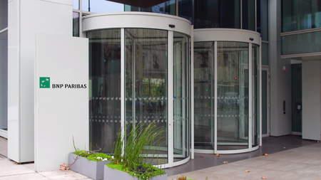 paribas: Street signage board with BNP Paribas logo. Modern office building. Editorial 3D rendering