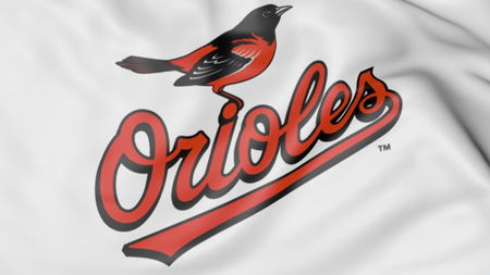 Close-up of waving flag with Baltimore Orioles MLB baseball team logo, 3D rendering