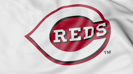 Close-up of waving flag with Cincinnati Reds MLB baseball team logo, 3D rendering