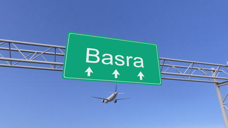 basra: Twin engine commercial airplane arriving to Basra airport. Travelling to Iraq conceptual 3D rendering Stock Photo