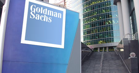 Street signage board with The Goldman Sachs Group, Inc. logo. Modern office center skyscraper and stairs background. Editorial 3D rendering