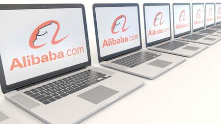 alibaba: Modern laptops with Alibaba.com logo. Computer technology conceptual editorial 3D