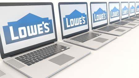 Modern laptops with Lowes logo. Computer technology conceptual editorial 3D Editorial