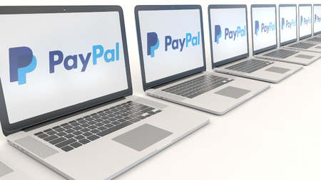 Modern laptops with PayPal logo. Computer technology conceptual editorial 3D Editorial