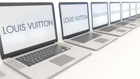 Modern laptops with Louis Vuitton logo. Computer technology conceptual editorial 3D