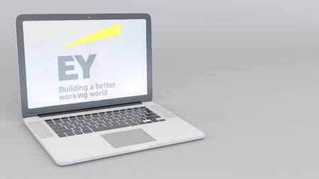 lawer: Laptop with Ernst & Young logo. Computer technology conceptual editorial 3D rendering
