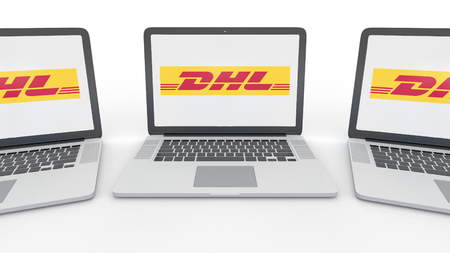 Notebooks with DHL Express logo on the screen. Computer technology conceptual editorial 3D rendering Editorial