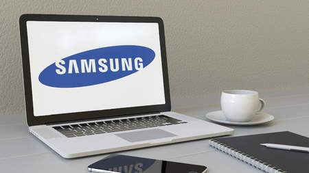 samsung: Laptop with Samsung logo on the screen. Modern workplace conceptual editorial 4K animation