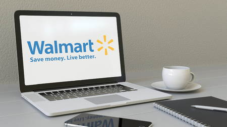 Laptop with Walmart logo on the screen. Modern workplace conceptual editorial 4K animation