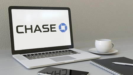 Laptop with JPMorgan Chase Bank logo on the screen. Modern workplace conceptual editorial 4K animation Publikacyjne