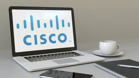 Laptop with Cisco Systems logo on the screen. Modern workplace conceptual editorial 4K animation Publikacyjne