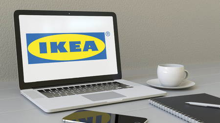 furniture store: Laptop with Ikea logo on the screen. Modern workplace conceptual editorial 4K animation