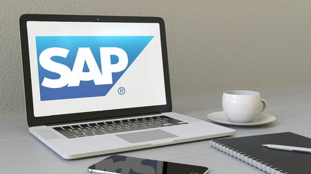 Laptop with SAP SE logo on the screen. Modern workplace conceptual editorial 4K animation