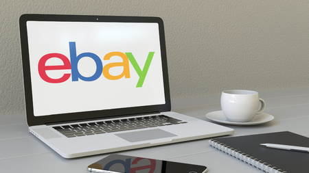 ebay: Laptop with eBay Inc. logo on the screen. Modern workplace conceptual editorial 4K animation Editorial