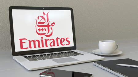 Laptop with Emirates Airline logo on the screen. Modern workplace conceptual editorial 4K animation Editorial