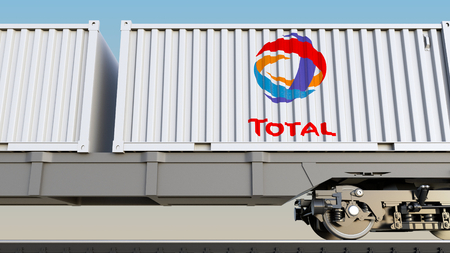 Railway transportation of containers with Total S.A. logo. Editorial 3D rendering Editorial