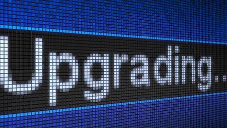 Ticker board running text Upgrading. Stock Photo